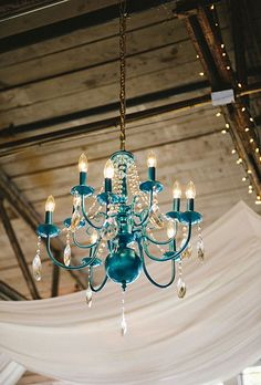 "Brides.com: A Whimsical Wedding in Deep River, Connecticut. ""My absolute favorite?"" Christina says. ""Two funky, ocean blue chandeliers were hung overhead just below the swags on each side of the room. Love, love, loved these."""