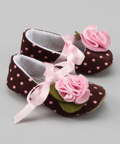 tiptoeing between fashion and function, these mary janes have soft soles with skid-resistant bottoms. They are handmade and embellished with precious petals in a sweet palette of colors.If I had a girl would definitely get this