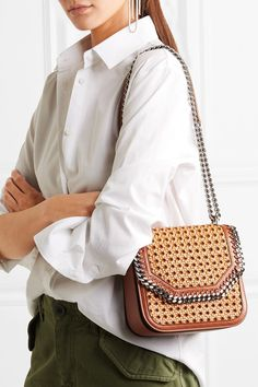 Tan and light-brown faux leather Snap-fastening front flap Comes with dust bag Weighs approximately 0.2lbs/ 0.1kg Made in Italy