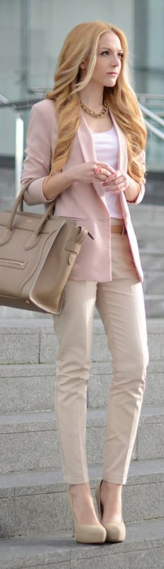 looks like a pants suit but actually two different shades of light pink blazer with a fitted trouser