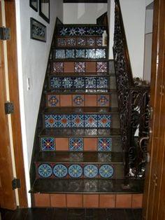 Tile stair risers by Melanie Yarak in the Jennings' home.