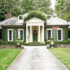 Louvered panels on both the front door and window shutters unite this facade in elegance, while a coat of garden-green paint on all players adds a kick of contrast to this cottage Traditional Front Doors, Traditional House, Traditional Shutters, Traditional Exterior, Exterior Design, Interior And Exterior, Exterior Paint, Exterior Colors, Green Shutters