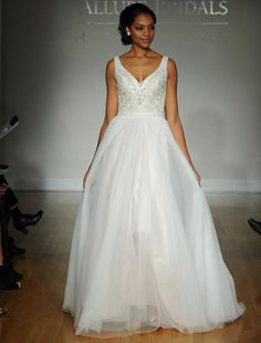 Allure fall 2016 wedding gown with plunging V neckline and beaded bodice with flowing full ball gown skirt   https://www.theknot.com/content/allure-wedding-dresses-bridal-fashion-week-fall-2016