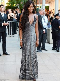 Naomi Campbell in a plunging, glittery silver number at the 2014 CFDA Fashion Awards. She accessorized with Lorraine Schwartz jewels.