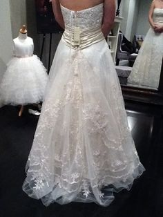 Higher Over Bustle On An A Line Lace Gown Is Seperately