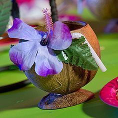 The are made from a real coconut and come complete with bendable straw and tropical flower. Each coconut cup are approximately 5 inches tall but may vary in size and shape