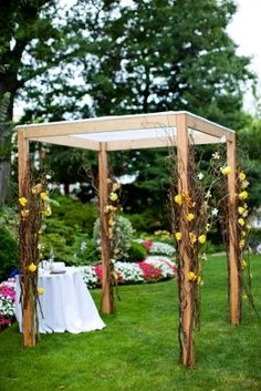 So, this is not the most attractive chuppah, but you could do something like this with branches and just tuck clusters of flowers...