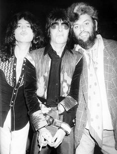 Jimmy Page, Ron Wood and Peter Grant photographed by Neal Preston, Nassau Coliseum, February 14, 1975.