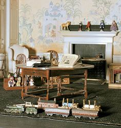 The Day Nursery in Queen Mary's Dolls' House    The Day Nursery in Queen Mary's Dolls' House showing an array of children's toys including a miniature train set, model theatre and tiny car.