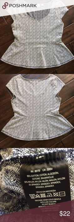 Anthropologie postmark peplum top Anthropologie postmark gray and black peplum top with a diamond abstract pattern print with cap sleeves. Length 22 inches bust 16 inches measurements taken from flat surface. Anthropologie Tops