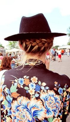 cute music festival hair idea: braid the back of your hair, under the hat