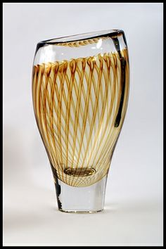 Vicke Lindstrand for Kosta   Clear glass vase internally decorated with amber vertical stripes, 1952-53.