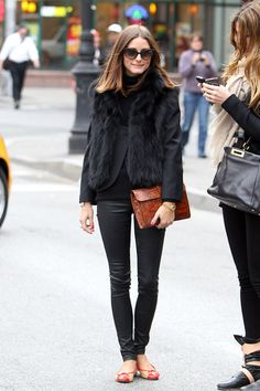 """Olivia Palermo Photos - Olivia Palermo, star of """"The City"""", wears a fur vest while having lunch with a friend at Sant Ambroeus in NYC. After lunch, the pair walked arm in arm down the street to a waiting cab. - Olivia Palermo at Sant Ambroeus in NYC"""