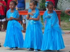 Three beautiful young Afro-Mexican girls preparing for a school ceremony in Chacahua, Mexico.....This photo was taken by Justin Scott Parr....