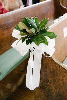 Magnolia leaves + white ribbon wedding ceremony aisle markers {Riverland Studios}
