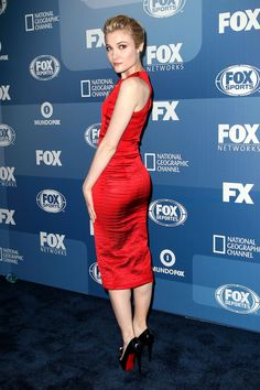 Skyler Samuels booty in a red silk dress and Louboutins