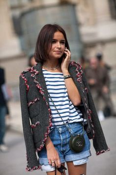 Miroslava Duma styles a striped tee with denim cutoffs and a tweed blazer. Click through for 50 more outfit ideas for striped shirts: