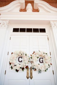 Floral Wreaths With Monograms on Doors | photography by http://jessicalewisphoto.com/