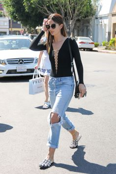 Lily Aldridge's lace-up body top dresses up her ripped boyfriend jeans.