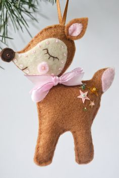 This lovely Felt Deer is 100% hand stitched and cut by hand from my own pattern. It is perfect for hanging on Christmas trees, walls, maybe even as a tag on a gift - a little bonus present! Or possibly a stocking filler...teacher gift, wedding favours ...the possibilities are endless!  ♥︎ This little deer is made from brown,red and white felt.  ♥︎ The eyes are made from black sequins and embroidered black eyelashes.  ♥︎ Its little bottom is speckled with star sequins and topped with a…