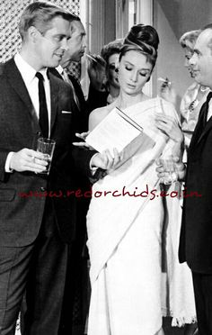 Audrey Hepburn, actress, style icon and tireless ambassador for UNICEF, would have been 85 on the 4th of May. IBN marked the event by showing this picture of Ms Hepburn in a saree, as seen in the 1961 film 'Breakfast at Tiffany's', where she plays New York socialite, Holly Golightly. In the accompanying article they write, 'with her hair up, and an almost invisible choli or a blouse, she carried the sari with perfect swag!' I certainly wouldn't disagree with that but do you notice that the…