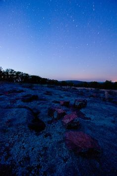 The stars shine in a night scenic from atop Stegall Mountain in Shannon County, Mo.