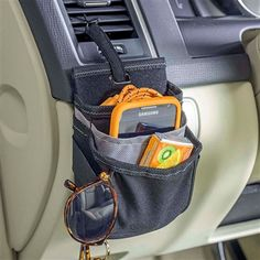 3-pocket cell phone holder for car dashboard is a car phone holder and USB car charging station. The perfect auto dash organizer for charging cords, sunglasses, iPhones and Android phones. High Road has a wide assortment of cell phone holders for cars. Mobile Command Center, High Road, Caravan, Motorhome, Camper