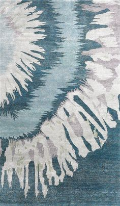 This tie dye inspired design features varying shades of turquoise, light blue, pale lilac, and lime green.