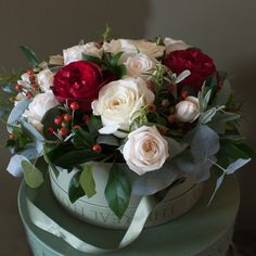 This Nordic style Hat Box Arrangement has a mixture of luxury scented Vitality & Snowballet roses with Red Sensation roses which are exclusively grown on our farm in Kenya. We have mixed these beautiful roses with Rose Hips in this deluxe arrangement with aromatic herbs and seasonal winter foliage, all grown on our English Farm. The hat box will make a lovely keep sake after the flowers have faded.
