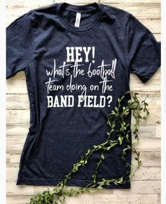 What's the football team doing on the band field? Crew Neck Unisex Fit T. Choose your team's color or your favorite color! Spirit Store, Favorite Color, Graphic Tees, Crew Neck, T Shirts For Women, Boutique, Unisex, Band, Sweatshirts