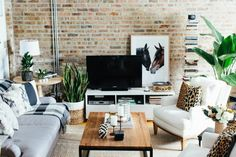 The Everygirl Cofounders' Chicago Home and Office Tour #theeverygirl  But seriously, where can I find that horse print!