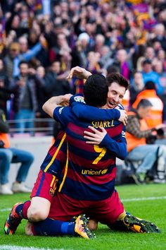 Luis Suarez of FC Barcelona celebrates with his teammate Lionel Messi after scoring his team's second goal during the La Liga match between FC Barcelona and Club Atletico de Madrid at Camp Nou on January 30, 2016 in Barcelona