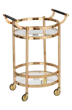 Swooning over this gorgeous goldtone bar cart that is perfect for entertaining guests.