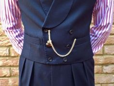 pocket watch chain (Albert style) w/ double breasted vest, & fob attached to drop