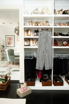 Love the white closet with dark floors.