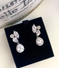 Crystal Bridal Earrings, Crystal Wedding Earrings, #clusterearrings #bridalearrings #weddingearrings #bridalaccessories #weddingjewelry #bridaljewelry #crystalearrings #czearrings #formal #promearrings #statementearrings #crystalbridal #dreamislandjewellery