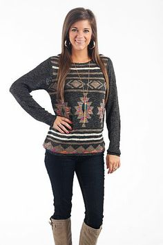 "Tribal Show Sweater, Black $39.00 We love metallic threads, tribal print AND sweaters...but all in one? Yes please! This too cute sweater is a winner in our book! The small pops of blue, pink, and yellow make it easily paired with your favorite colorful jewelry. Due to it being a semi-loose knit, you may want to wear a layering tank underneath this item.   Fits true to size. Miranda is wearing a small.   From shoulder to hem:  Small/Medium- 25.5""  Medium/Large- 26.5"""