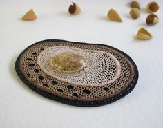 "Lenka Veselá, brooch ""Imprints"" - needle lace with mineral stone. Cotton, linen, jasper, imitation leather. Cca 10.5 x 7 cm"