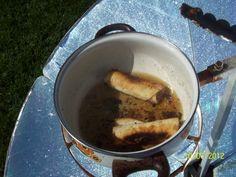 Overcooked Solar Taquitos on the Solar Burner...oil go too low.  St. George, Utah
