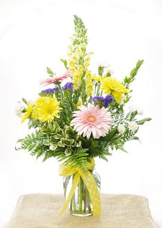 Send a big beautiful arrangement to make someone's day a little brighter!