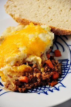 This classic shepherd's pie is made with ground beef and guinness beer! Loaded with lots of veggies and topped with cheesy mashed potatoes!