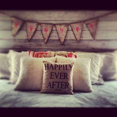 So cute! Love the reclaimed wood headboard and the bunting on it!!
