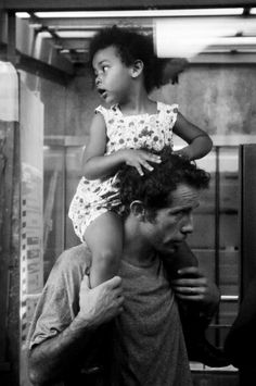 I'm on the train. Just a second before the departure..., she is here! Between us just a glass, a silence and some reflections. She is sitting on the shoulders of her father, on the shoulders of the man who really trusts.I was in the train... That was my decisive moment, my métis moment that i cannot forget...