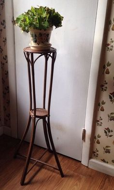 Vintage wood and rattan tall slender plant stand 2 shelf round brown painted