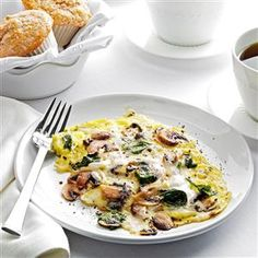 Spinach-Mushroom Scrambled Eggs Recipe -My husband and I had breakfast at a hotel and enjoyed an amazing mushroom egg dish. As soon as I got home, I made my own rendition. —Rachelle McCalla, Wayne, Nebraska