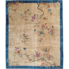 Chinese Art Deco Carpet, China.  Circa 1920. Simple & Elegant! An ivory field with flower bursts, surrounded by a medium blue border.