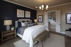A Navy blue accent wall in the bedroom creates a look of elegance and depth. This dark blue wall color pairs especially well with neutral furniture to make this master bedroom a calming retreat. Dark Blue Bedrooms, Blue Master Bedroom, Master Bedroom Makeover, Master Bedroom Design, Home Bedroom, Bedroom Decor, Bedroom Ideas, Navy Bedrooms, Bedroom Designs