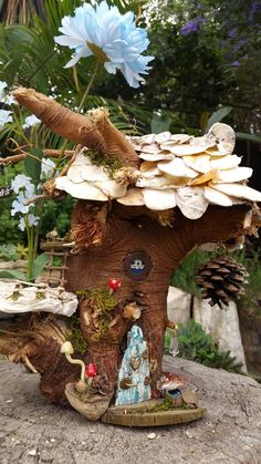 PERIWINKLE COTTAGE. 3 days to builds...oh the detail. I challenged myself to build a shell roof that doesn't look so 'obviously shelly'. Found these shells while on holiday. Attached to a wooden base construction, they were perfect. The balcony is also made croon a large shell with great texture. See other posts for close ups...