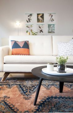 White living room with lots of bright color and geometric patterns