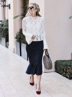 Pair a statement sweater with a classic skirt like Damsel in Dior.